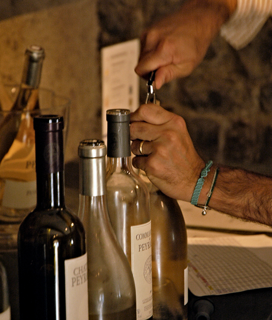 Photo of Alban opening wine bottles for our tasting
